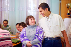 Happy people with disability in rehabilitation